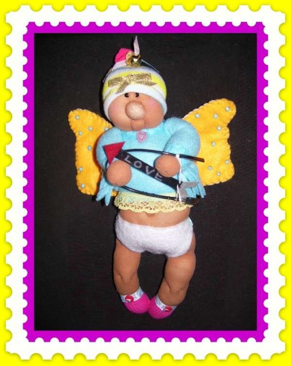 Completed pantyhose Cupid hanging.