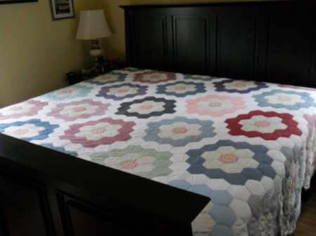 Flower Garden Quilt on bed.