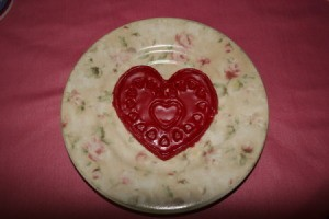 Heart shaped wax freshener cooling on a plate.