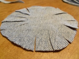Circle with slits cut into it.