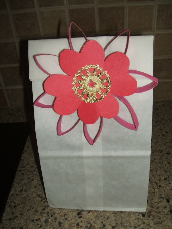 Flower attached to gift bag.
