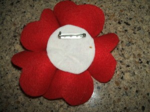 Pin back on heart petal flower.