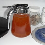 Honey being stored in a syrup dispenser.