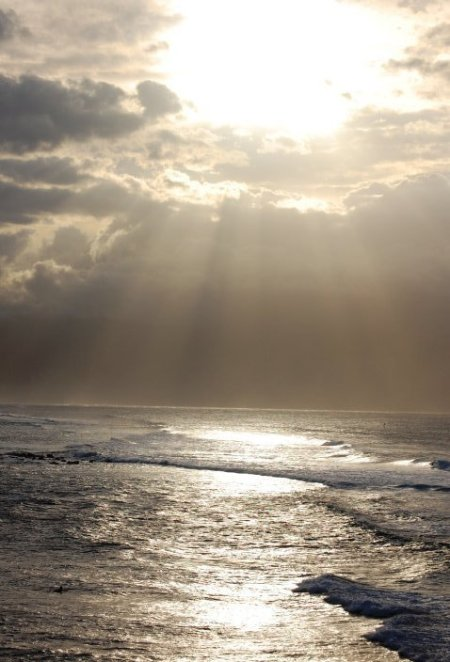 Scenery: Ocean (Maui, Hawaii) - waves with the sun shining through the clouds.
