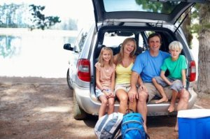 Traveling With Kids, Family on Vacation in the back of Their Car