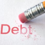 "A pencil eraser that is erasing the word ""Debt"""