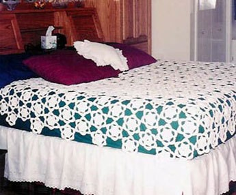 A bedspread that can look like flowers or snowflakes, depending on the season.