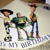 A homemade birthday party hat with Woody, Jessie and Buzz Lighteyear.