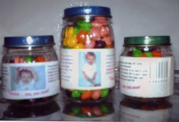 Baby food jars filled with candy as a favor.