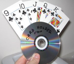 A holder for a hand of cards from a recycled CD