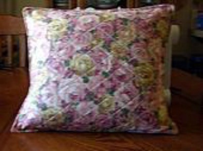 A flowered throw pillow cover.