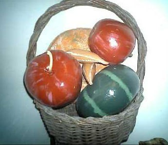 A basket with brightly painted gourds.