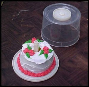 A birthday cake for just one, served in a recycled CD spindle.