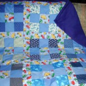 Repurposing Clothing In Crafts by making a quilt.