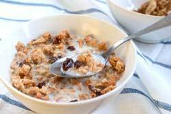 A bowl of granola with milk.