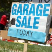 A blue garage sale sign.