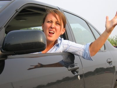 Photo of a lady yelling at a driver.