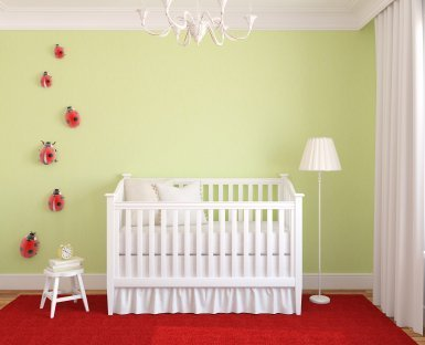Baby nursery with a white crib.