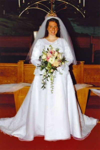Bride wearing a wedding dress.