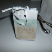 decorated white envelop bag tied with ribbon