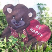 Bear with a heart sign Be Happy.