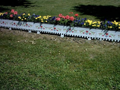driveway planter with flowers