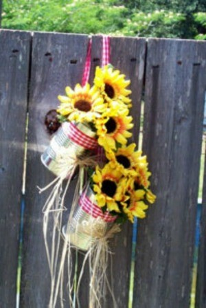 Tin can flower holder for wedding.