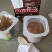 Cups of pudding and yogurt.