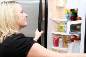 Woman opening the refrigerator.