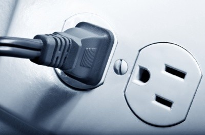 An electric plug in an outlet.