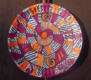 A spiral twirler for decoration, made from a paper plate.