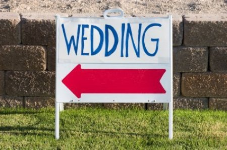 Sign Pointing to a Wedding