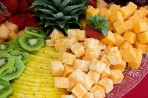 A platter of fruit and cheese.