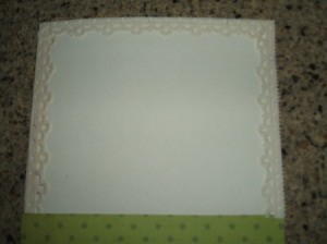 Scalloped edge glued to card.