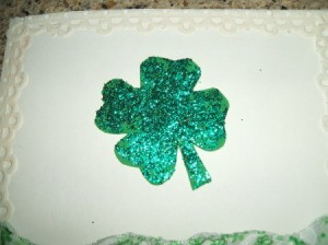 Shamrock glued to top of card.