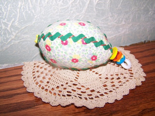Floral egg with rick rack and buttons.