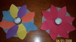 Two finished flowers multicolored and pink.