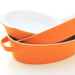 A stack of orange casserole pans.