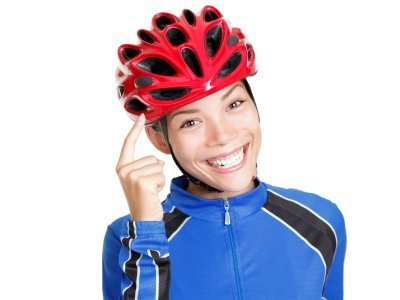 A woman wearing a bike helmet.