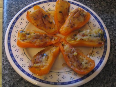 Plate of stuffed yellow pepper halves.