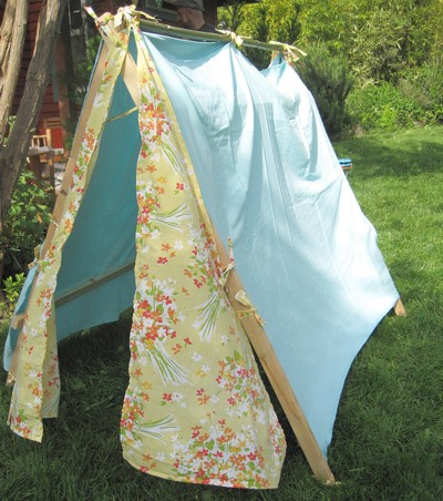 Make a summer play tent from old sheets.