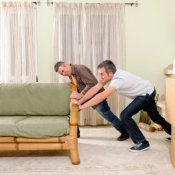 Two Men Moving Sofa