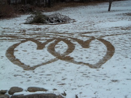 Two hearts caused by tire tracks in the snow.