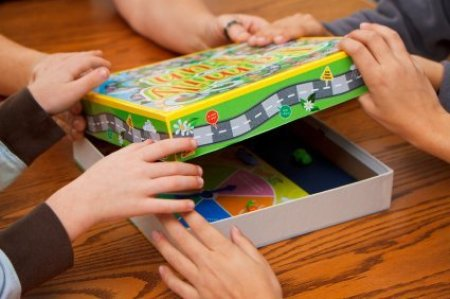 A family opening a board game.