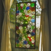 A stained glass window using cut wine bottle bottoms.