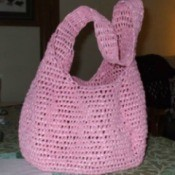 A recycled market bag made from plastic grocery bags.