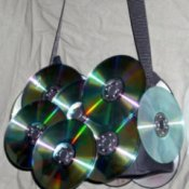Purse decorated with CDs.