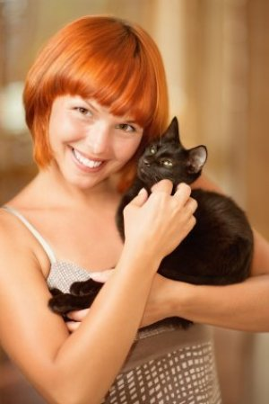 Woman holding a cat.