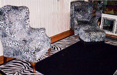 Refurbished chairs in a zebra print.