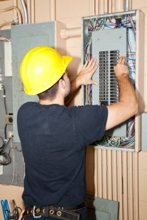 Electrician Working on Circuit Breakers